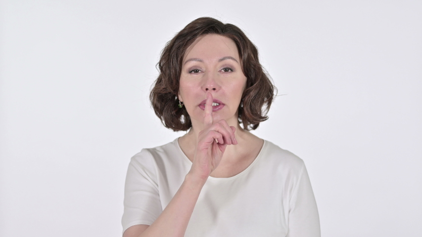 Old Woman with Finger on Lips on White Background  | Shutterstock HD Video #1047203593