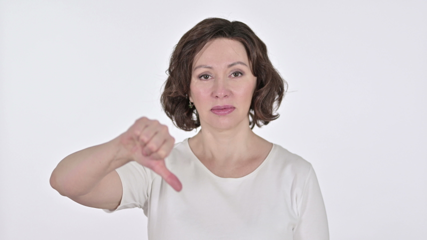Thumbs Down by Disappointed Old Woman, White Background  | Shutterstock HD Video #1047211801