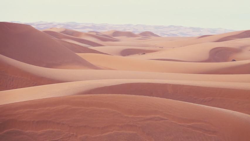 Horizonless Sand Dunes in Wahiba Sands Desert, Oman. Pan Shot | Shutterstock HD Video #1047224965