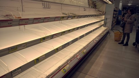 Milan Italy February 25, 2020: Empty shelves in grocery stores. Panic from the Chinese Covid19 virus corona in Italy. People bought all the meat and pasta. Quarantine in Milan. Epidemic. Panic