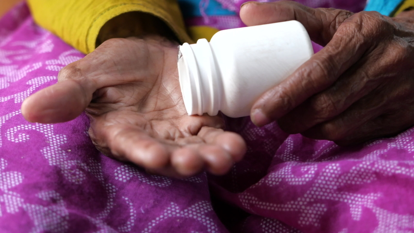 Close up of senior women taking pills , health and medicine    Shutterstock HD Video #1047231757
