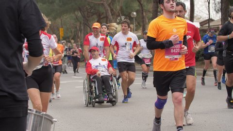 Barcelona, Spain. February 15th 2020: Percussion Music Band cheering for Athletes running a Half Marathon. Crowd of happy Runners greeting on the background
