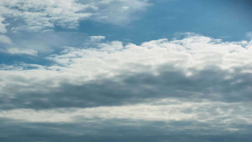 Time lapse clouds rolling puffy cloud movie Royalty-Free Stock Footage #1047252025