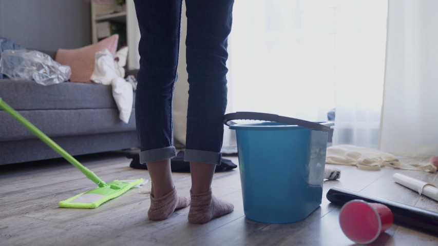 Woman horrified by mess left after party in her apartment, cleaning service. Housekeeper feeling shocked by room view after bachelor event, chaos and dirt washing, exhausted overworked wife, cleaner | Shutterstock HD Video #1047313270