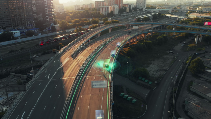 Amazing aerial presentation of the autonomous cars self-driving concept on the sunny evening in Moscow. Beautiful view from above to the road traffic on multi-level highway of big city. | Shutterstock HD Video #1047327664