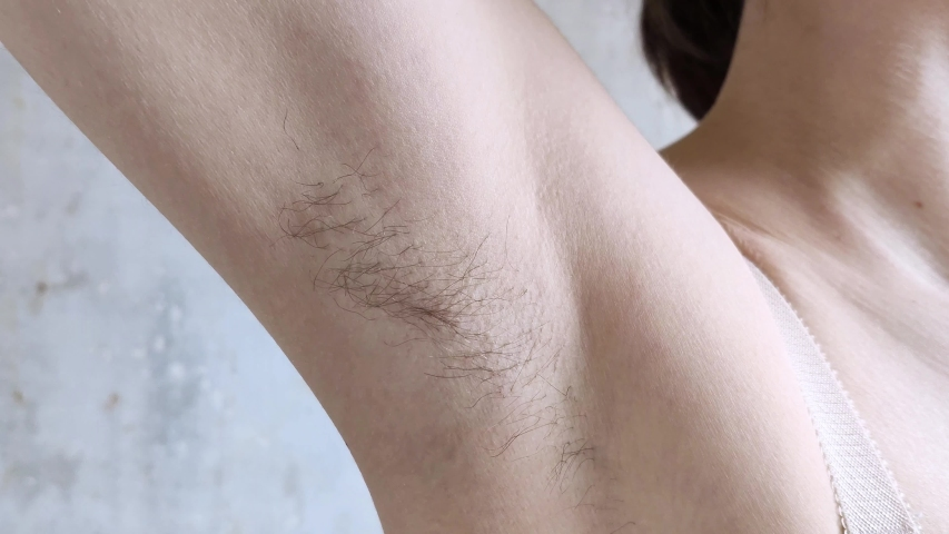 Unshaven armpit. Without hair removal and shaving. Natural female white body. Close-up. Self acceptance, untidy, body positive theme | Shutterstock HD Video #1047402880