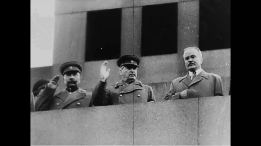 CIRCA 1950s - Joseph Stalin oversees a May Day military parade in Red Square.