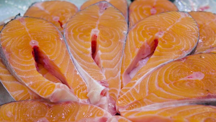 Salmon steaks on counter in a supermarket. | Shutterstock HD Video #1047451825