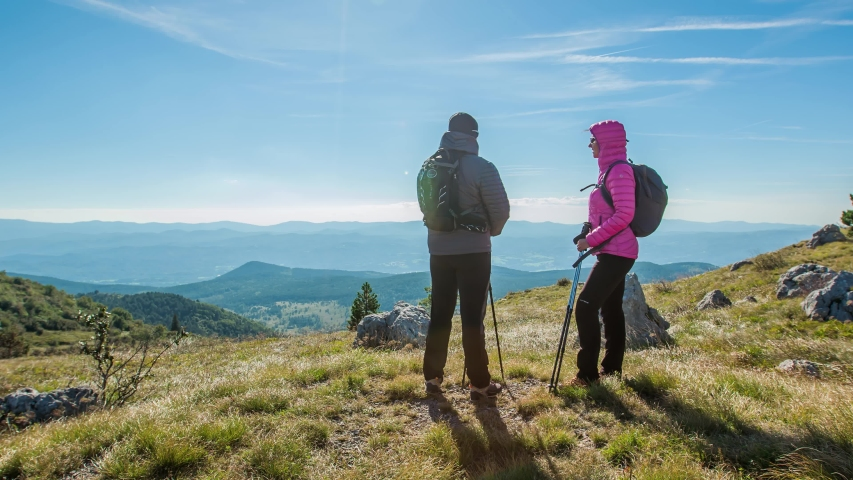 Hikers on Viewpoint at Mountain Top, Man Puts his Arm Around Girlfriend Shoulder | Shutterstock HD Video #1047486880