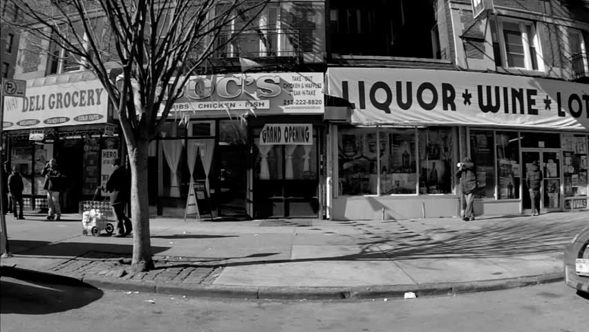 NEW YORK - FEB 9, 2010: taxi cab and liquor wine store, Upper West Side, Manhattan, black and white vintage style footage, driving in NY. Upper Westside is a famous neighborhood in Manhattan, NYC.