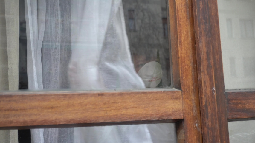 Italy , Milan - European white boy children quarantine with mask looks out the window of the house - contagion of the Novel Coronavirus 2019- ncov -  virus incubation isolation       Royalty-Free Stock Footage #1047532099
