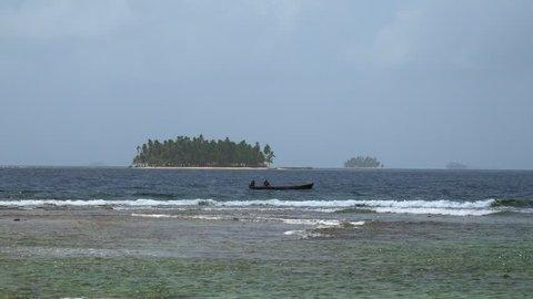 Panama City, Panama - June 15, 2015: Isla Aguja, archipelago of San Blas islands. View of kuna fishermen on boat