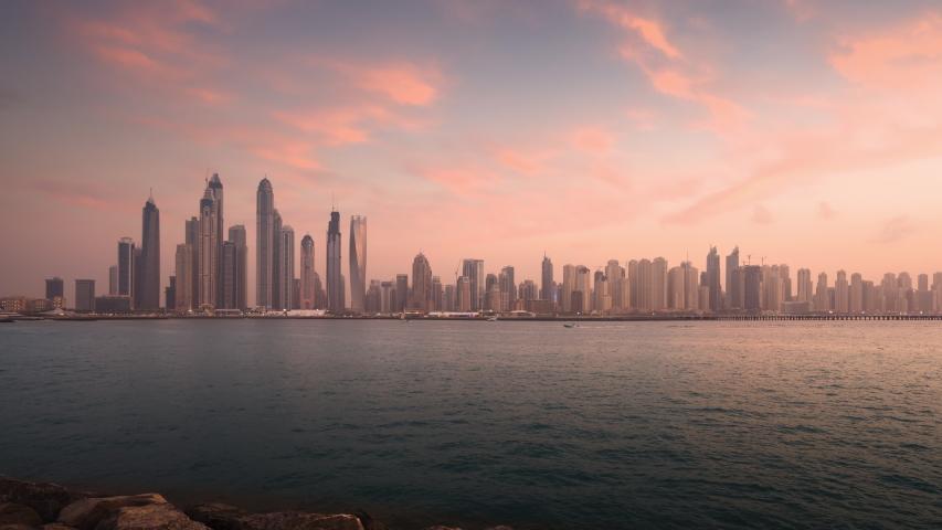Timelapse of skyscrapers in Dubai Marina, sunset time, UAE   Shutterstock HD Video #1047545080