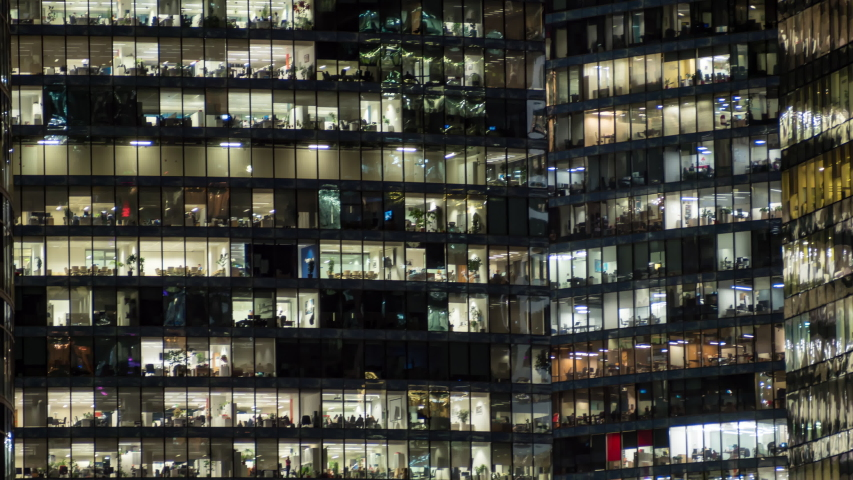 View of office windows with working people #1047554863