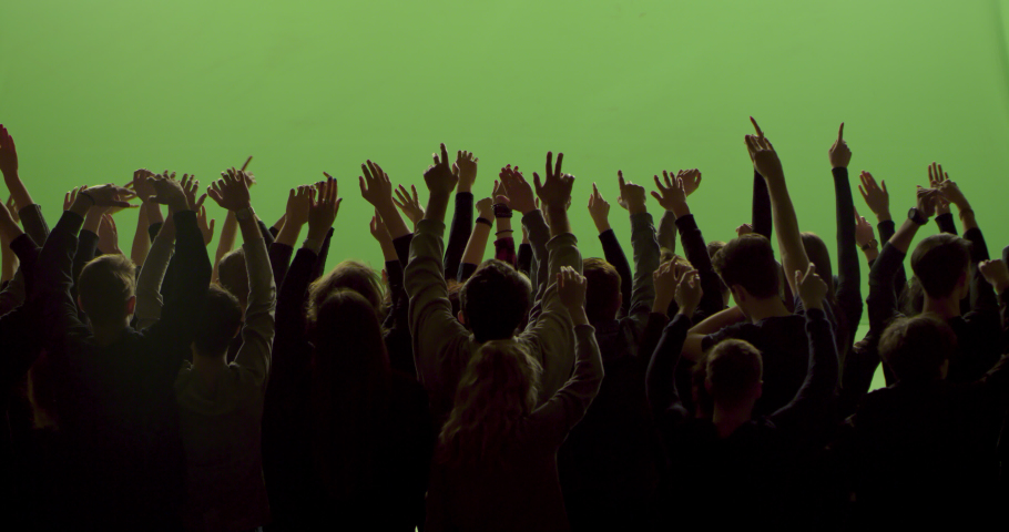 GREEN SCREEN CHROMA KEY Model released, back view of huge crowd dancing and cheering at a concert or a show. Shot on RED Helium 8K in RAW