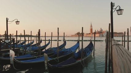 Video of an empty Venice in Italy; a swinging boat on the shore; no people; coronavirus in Italy