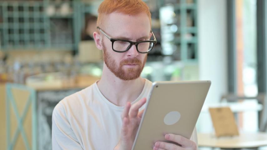 Portrait of Professional Redhead Man using Digital Tablet  | Shutterstock HD Video #1047594124