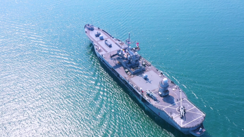 Amphibious Assault Ship. Navy aircraft carrier Aerial top view of battleship, Military sea transport, Military Navy Rescue Helicopter on board the battleship deck
