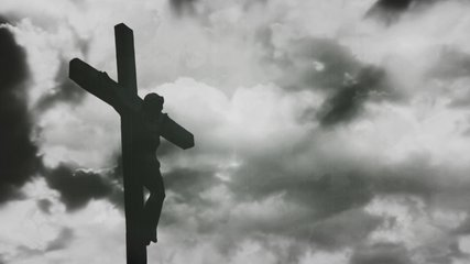 Jesus Christ crucified at Golgotha hill outside ancient Jerusalem. The Crucifixion of Christ with Stormy clouds time lapse. Vintage film look, 4k video