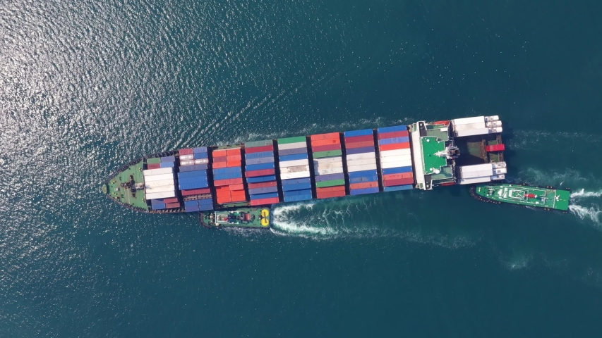 Aerial view cargo ship of business logistic transportation sea freight,Cargo ship, Cargo container in factory harbor at industrial estate for import export around in the world, Trade Port / Shipping  | Shutterstock HD Video #1047614425