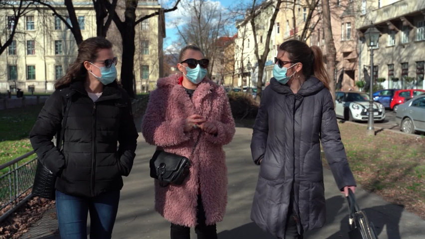 Women wearing mask for protection against coronavirus 2019-nCoV Royalty-Free Stock Footage #1047614800