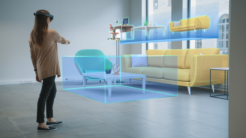 Decorating Apartment: Pretty Woman Wearing Mixed Reality Headset Uses Augmented Reality Interior Design Software to Choose 3D Furniture for Living Room. She Pick Furniture. 3D Render Royalty-Free Stock Footage #1047633142