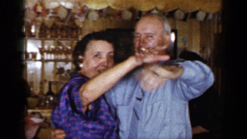 LONG ISLAND NEW YORK-1965: Grandma And Grandpa Share A Dance Together And Wave At The Camera
