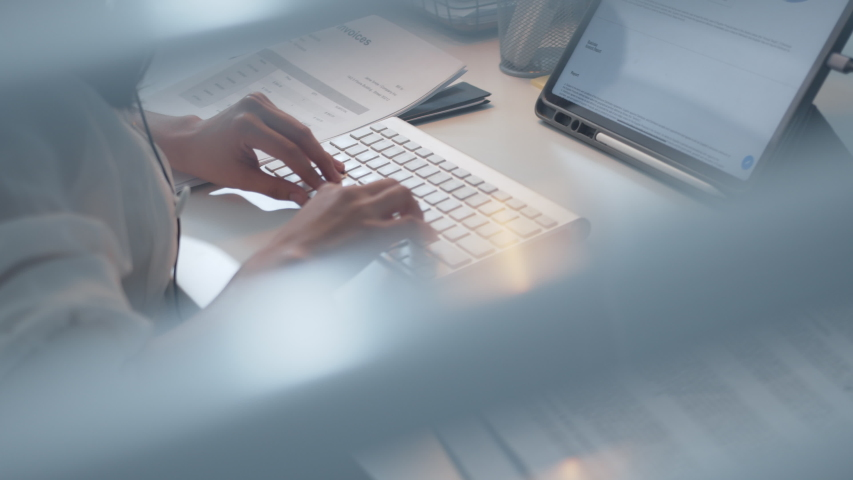 Pan Shot of Businesswoman hands typing on desktop computer keyboard for searching information, marketing research, online communication support and make a business report in the office desk at night. Royalty-Free Stock Footage #1047652429