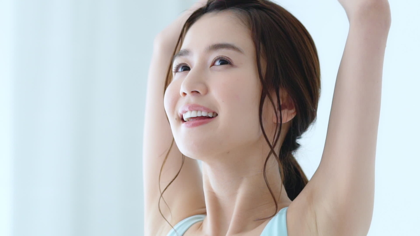 Stretching young asian girl. Health care concept. | Shutterstock HD Video #1047678535