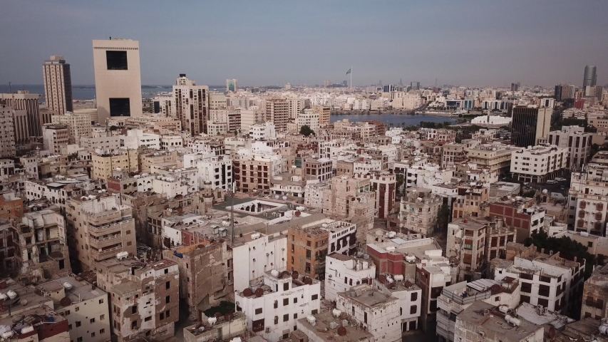 Retreating drone flight over Unesco World Heritage site of Al Balad with the skyline of Jeddah in the background, urban landscape Saudi Arabia