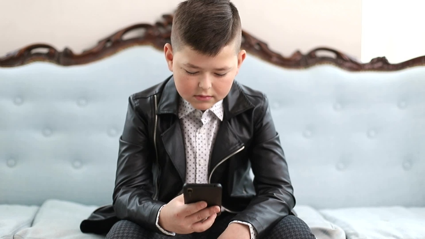 Little boy dressed in black leather jacket, photographed on magazine cover, boy model | Shutterstock HD Video #1047710173