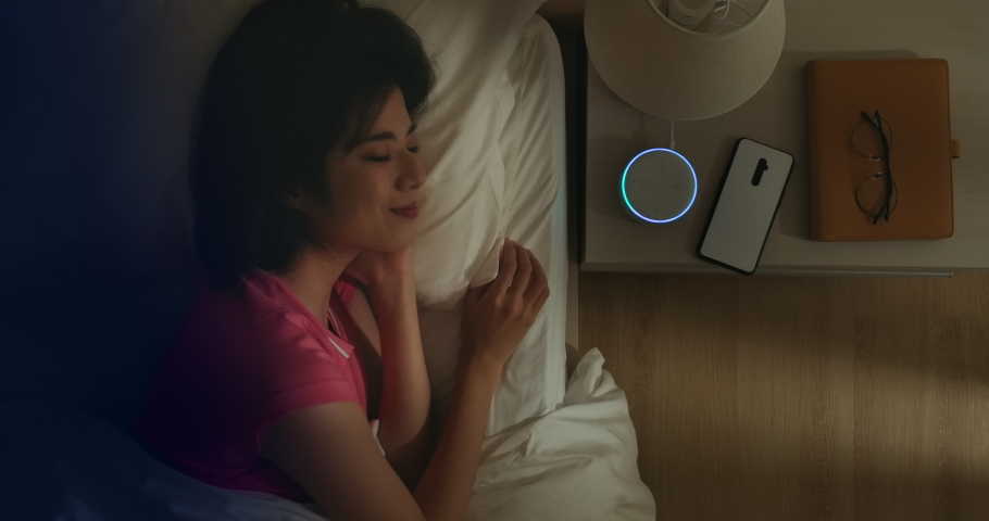 IOT AI smart home concept - Asian woman talk with voice assistant to turn off the lights of house at home while sleeping Royalty-Free Stock Footage #1047732157
