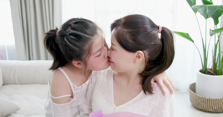 Slow motion - Happy Mother day- daughter give mom flower and kiss mom