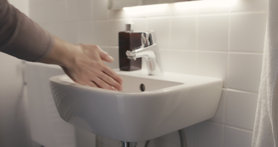 Woman washing hands the best way rinse with water rub with soap dry with towel virus outbreak protection | Shutterstock HD Video #1047758791