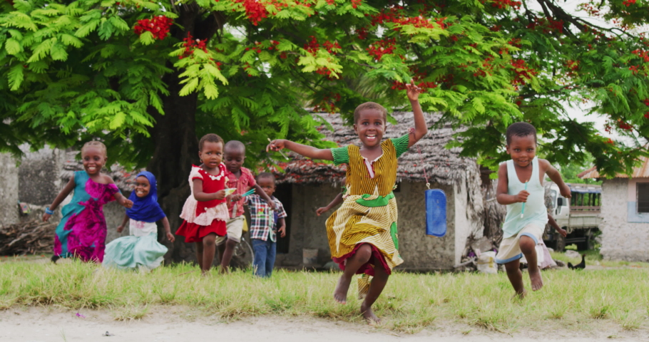 Authentic shot of happy carefree rural african kids friends are having fun to run and laughing in a sunny day on a village background. Concept: freedom, charity ,life, happiness, authenticity, friends Royalty-Free Stock Footage #1047766714