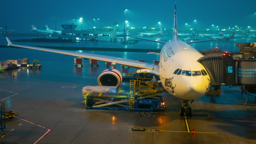 ChekLapKok Airport,HONGKONG MAR 2019 :Time lapse ground staff Preparing the aircraft before flight Loading of baggage Food for flight services and equipment before boarding the airplane at night time