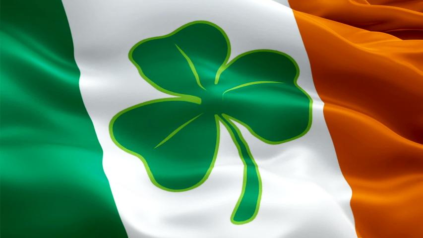 Saint Patrick flag Ireland video waving in wind with four leaf clover. St Patrick Irish Flag background. Ireland Flag Looping Closeup 1080p Full HD 1920X1080 footage. 4 leaf clover Ireland EU European   Shutterstock HD Video #1047816481