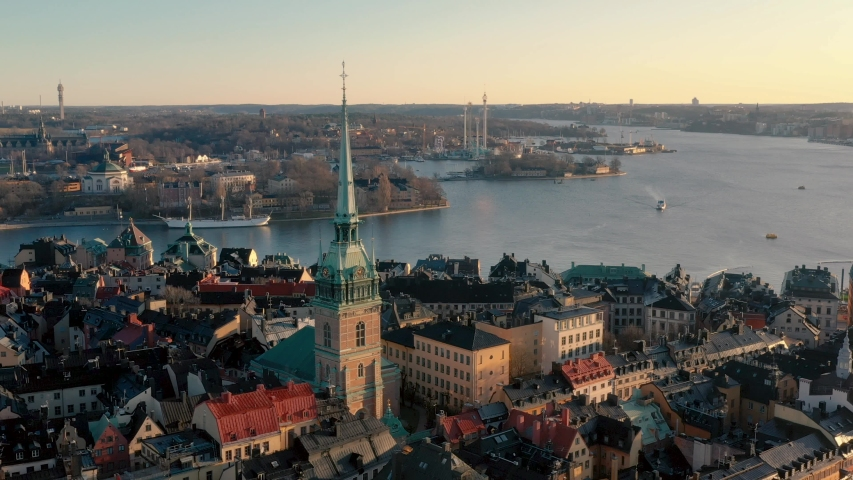 STOCKHOLM, SWEDEN - FEBRUARY, 2020: Aerial view of Stockholm city centre Gamla stan. Flying over buildings in old town.