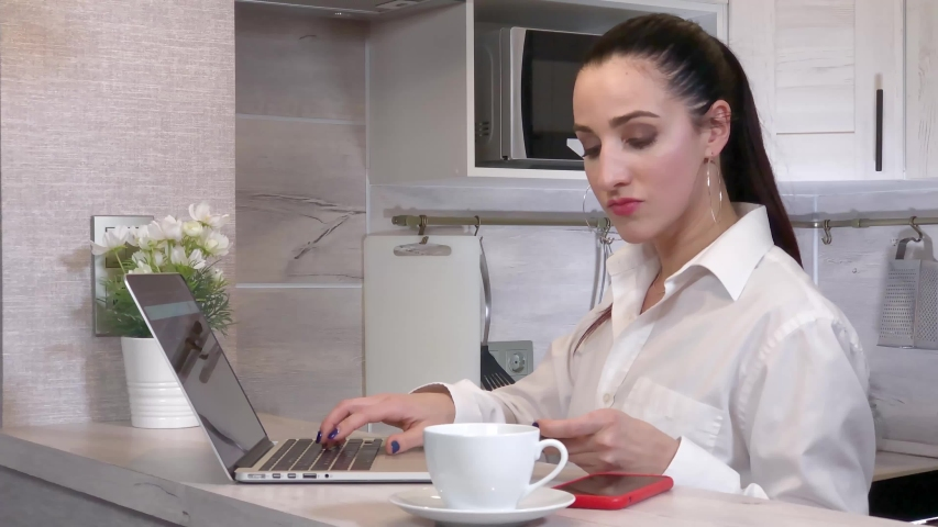 Young woman in a hurry to pay online order using laptop and credit card while the discount is valid Royalty-Free Stock Footage #1047841282