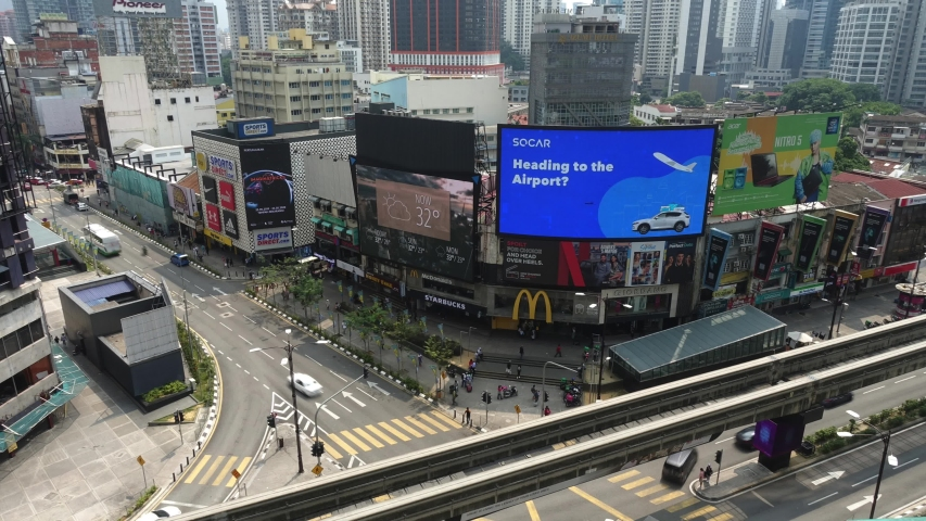 KUALA LUMPUR, MALAYSIA - JUL 27, 2019: Timelapse shot of Bukit Bintang cross junction with a lots of people, car passing and the oldest McDonald store in Malaysia | Shutterstock HD Video #1047841576