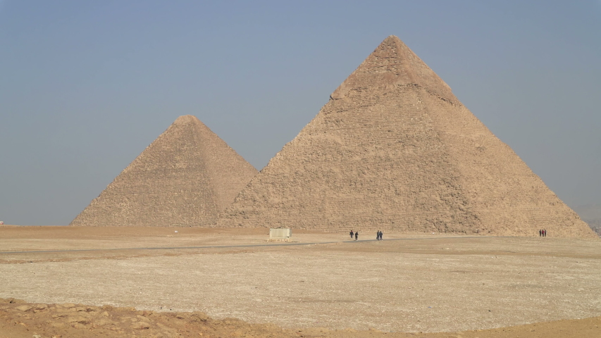 The Great Pyramid of Giza also known as the Pyramid of Khufu (Cheops) and  the Pyramid of Khafre (Chephren), located on the Giza Plateau in Cairo, Egypt | Shutterstock HD Video #1047851014