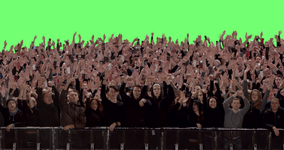 GREEN SCREEN CHROMA KEY Model released, Front view of huge crowd dancing and cheering at a concert or a show behind control barrier. Shot on RED Helium 8K Prores 4444 | Shutterstock HD Video #1047870601