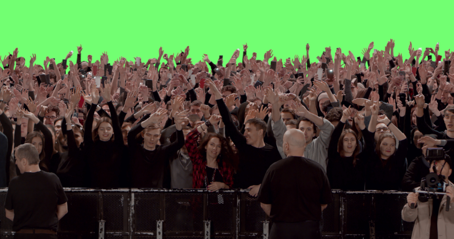 GREEN SCREEN CHROMA KEY Model released, Front view of huge crowd dancing and cheering at a concert or a show behind control barrier. Shot on RED Helium 8K Prores 4444 | Shutterstock HD Video #1047870613