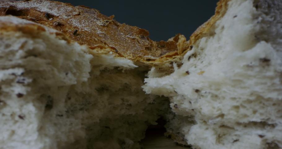 MACRO Dolly in breaking fresh baked bread. 60 FPS SLOW MOTION   Shutterstock HD Video #1047870664