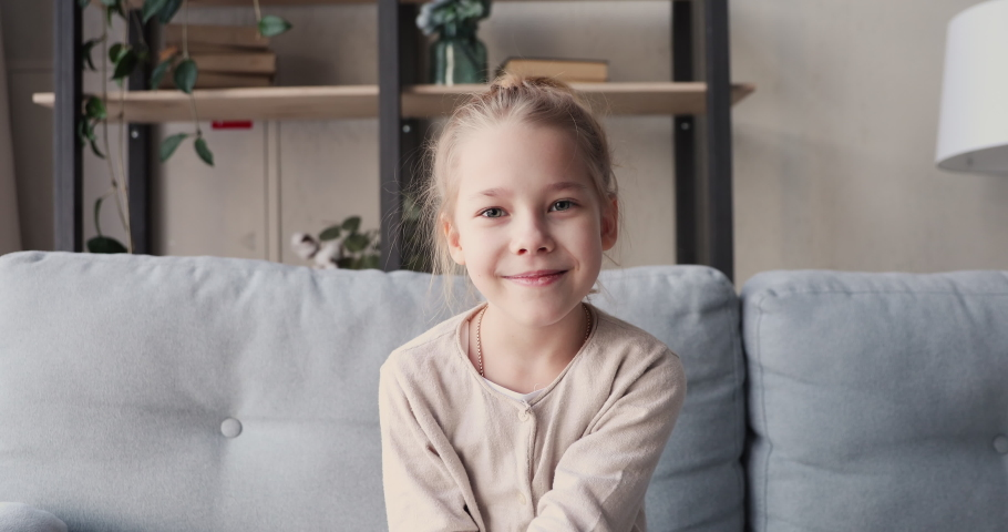 Funny child girl blogger or vlogger social media influencer talking to camera shooting vlog. Cute 6-7 years kid speaking to webcam video calling at home or shooting blog. Children vlogging concept Royalty-Free Stock Footage #1047907054