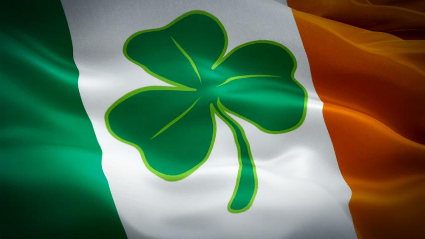Ireland waving flag with four leaf clover. St Patrick day 3d Irish flag waving. Sign of Ireland seamless loop animation. Irish flag HD resolution Background. lucky Shamrock Ireland flag Closeup 1080p    Shutterstock HD Video #1047918814