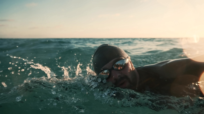 Professional Triathlete Swimming Workout.Triathlete Swim Preparing To Sport Triathlon Competition.Professional Swimmer Workout Training Triathlon Competition In Open Water.Swimmer Sport Exercising Royalty-Free Stock Footage #1047921922