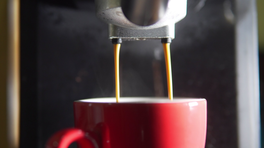 Footage B Roll of Pouring coffee stream from machine in cup. Home making hot Espresso. Using filter holder. Flowing fresh ground coffee. Drinking roasted black coffee in the morning.  | Shutterstock HD Video #1047924769