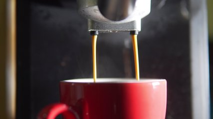 Footage B Roll of Pouring coffee stream from machine in cup. Home making hot Espresso. Using filter holder. Flowing fresh ground coffee. Drinking roasted black coffee in the morning.