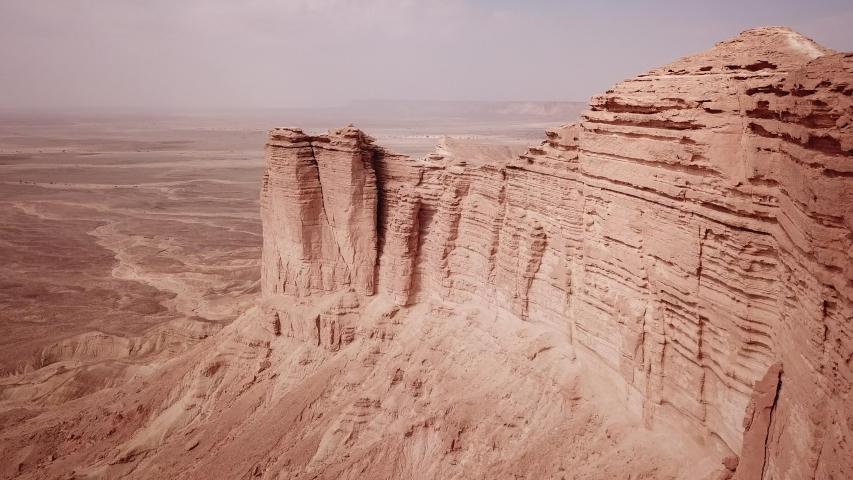 Drone flight of rugged mountain scenery and surreal landscape of the Tuwaiq Escarpment and Edge of the World in Saudi Arabia